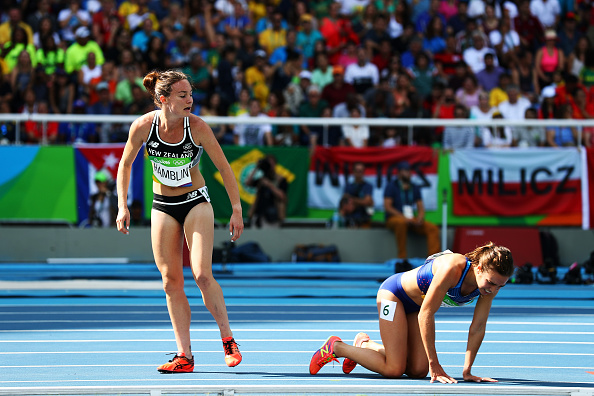 RIO DE JANEIRO, BRAZIL - AUGUST 16: Abbey D'Agostino of the United States (R) and Nikki Hamblin of New Zealand react after a collision during the Women's 5000m Round 1 - Heat 2 on Day 11 of the Rio 2016 Olympic Games at the Olympic Stadium on August 16, 2016 in Rio de Janeiro, Brazil. (Photo by Ian Walton/Getty Images)